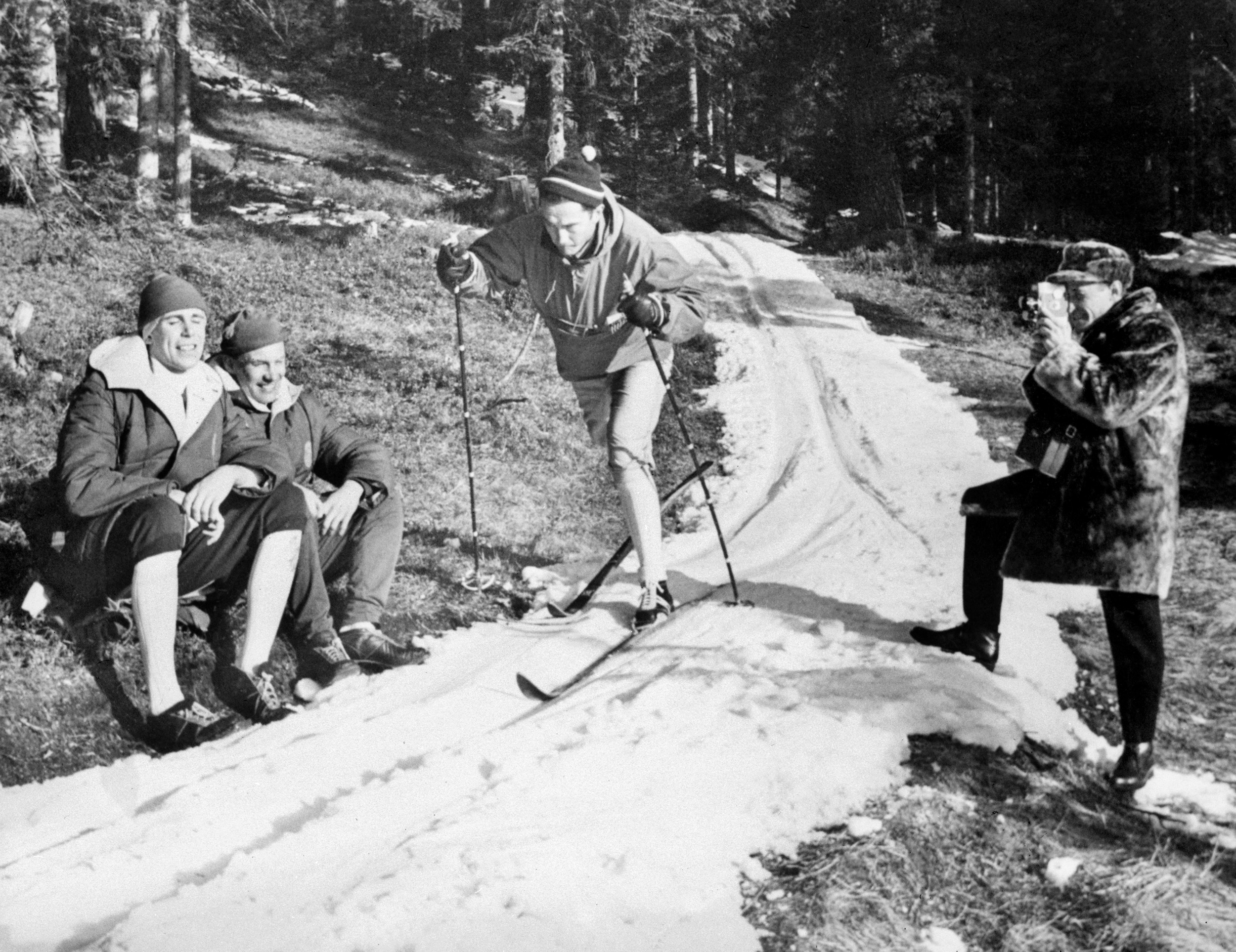 black and white photo of a man skiing