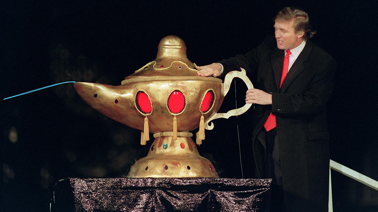 Donald Trump, in 1990, rubbing a magic lamp at the opening of his casino the Trump Taj Mahal