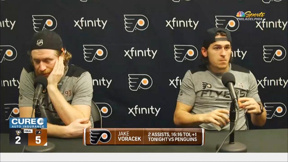 Jakub Voracek of the Philadelphia Flyers sits at a table for a presser.
