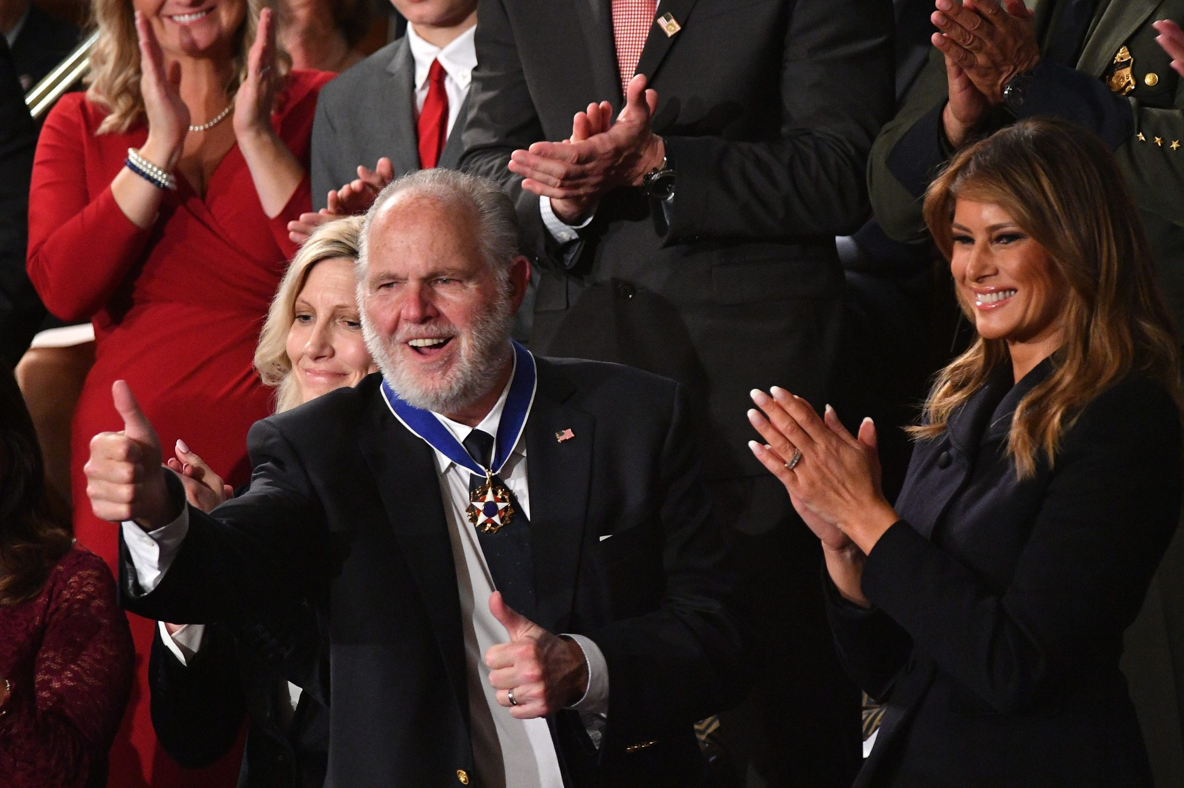 Rush Limbaugh, who has since died, celebrates after receiving the Presidential Medal of Freedom.