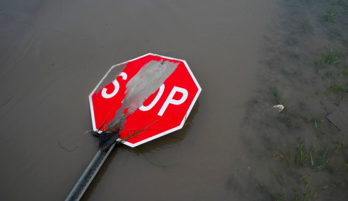 HOLLY BEACH, LA - AUGUST 27: A damaged stop sign sit among flood water after Hurricane Laura passed through the area August 27, 2020 in Holly Beach, Louisiana. Hurricane Laura came ashore bringing rain and high winds to the South East region of the state causing extensive damage to the area. (Photo by Eric Thayer/Getty Images)