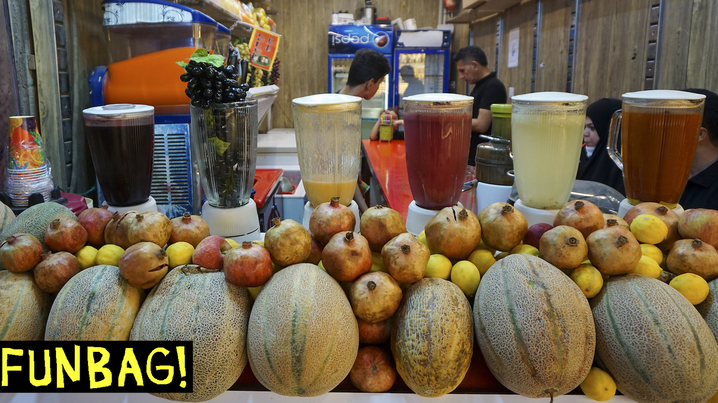 Iraqis drink juice at a shop in a market in Iraq's central shrine city of Najaf on September 15, 2020, during the coronavirus pandemic. (Photo by Sabah ARAR / AFP) (Photo by SABAH ARAR/AFP via Getty Images)