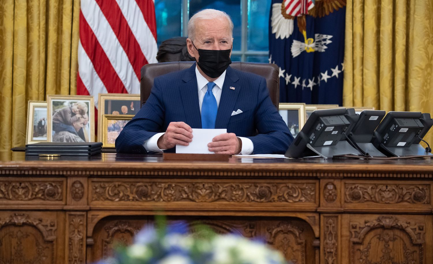 US President Joe Biden speaks before signing executive orders related to immigration in the Oval Office of the White House in Washington, DC, February 2, 2021. (Photo by SAUL LOEB / AFP) (Photo by SAUL LOEB/AFP via Getty Images)