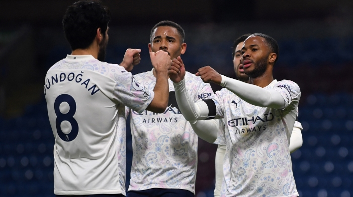 Manchester City's English midfielder Raheem Sterling (R) celebrates scoring his team's second goal with Manchester City's Brazilian striker Gabriel Jesus (C) during the English Premier League football match between Burnley and Manchester City at Turf Moor in Burnley, north west England on February 3, 2021.