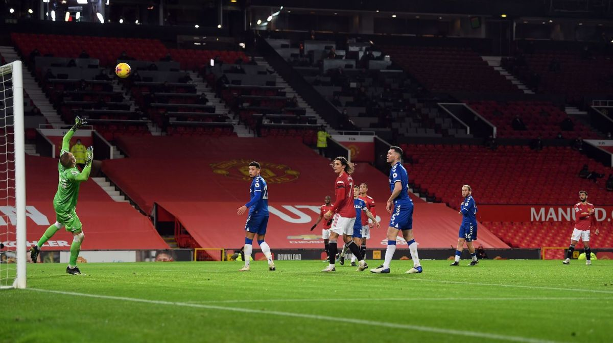 Manchester United's Portuguese midfielder Bruno Fernandes (R) scores his team's first goal during the English Premier League football match between Manchester United and Everton at Old Trafford in Manchester, north west England, on February 6, 2021.
