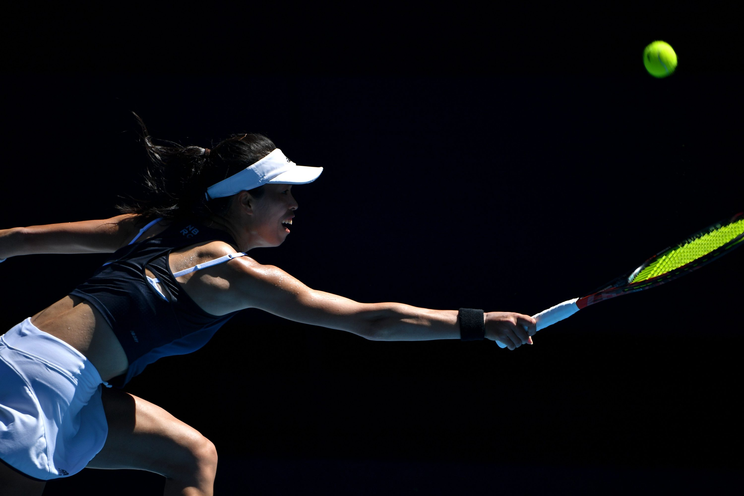 Taiwan's Su-Wei Hsieh hits a return against Bianca Andreescu of Canada during their women's singles match on day three of the Australian Open tennis tournament in Melbourne on February 10, 2021.