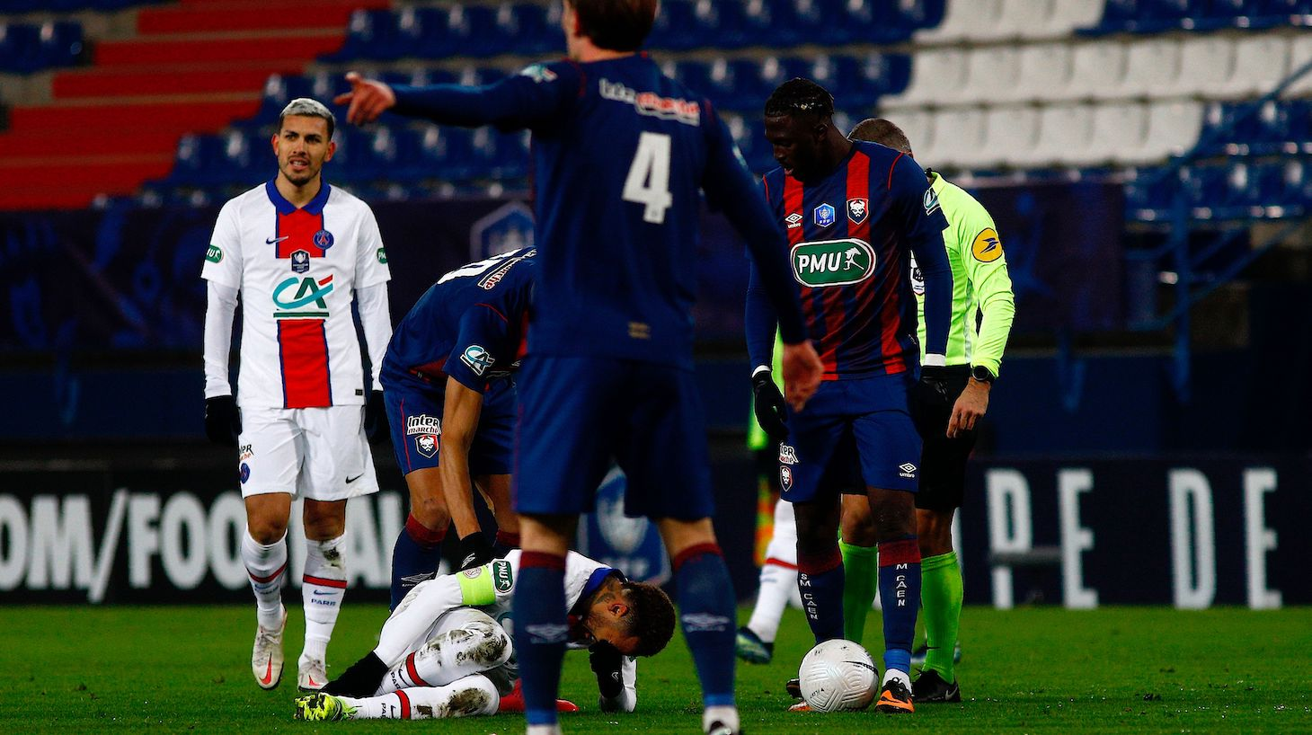 Paris Saint-Germain's Brazilian forward Neymar (3rd-L) reacts on the lawn during the French Cup round-of-64 football match between Stade Malherbe Caen and Paris Saint-Germain at the Michel-d'Ornano Stadium in Caen, northwestern France on February 10, 2021.