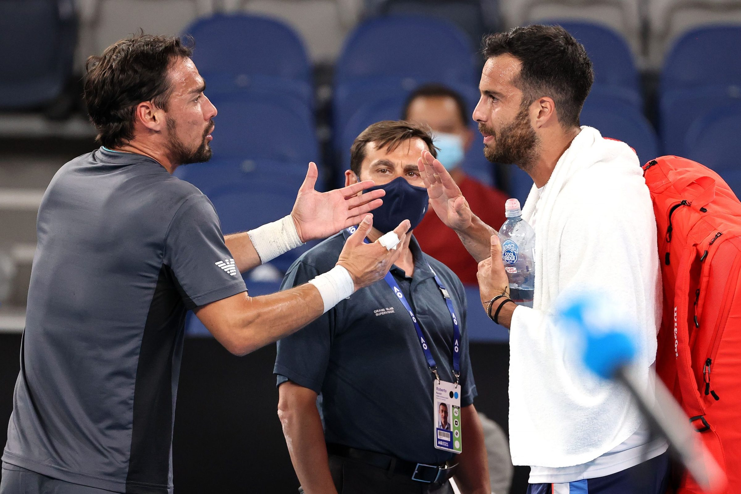 Fabio Fognini and Salvatore Caruso argue after their Australian Open match.