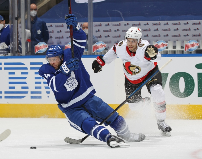 Artem Zub #2 of the Ottawa Senators draws a penalty for pulling down Morgan Rielly #44 of the Toronto Maple Leafs