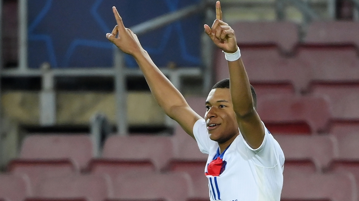 Paris Saint-Germain's French forward Kylian Mbappe celebrates after scoring his team's fourth goal during the UEFA Champions League round of 16 first leg football match between FC Barcelona and Paris Saint-Germain FC at the Camp Nou stadium in Barcelona on February 16, 2021