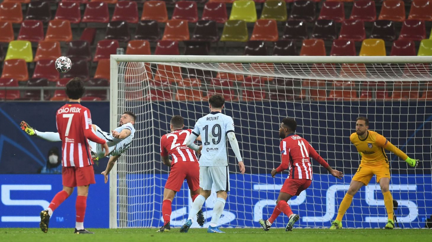 Chelsea's French striker Olivier Giroud (L) scores during the UEFA Champions League round of 16 first leg football match between Club Atletico de Madrid and Chelsea at the Arena Nationala stadium in Bucharest on February 23, 2021.
