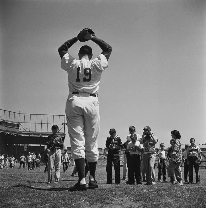 Kids photograph a pitcher for the Pacific Coast League's Oakland Acorns in 1952.