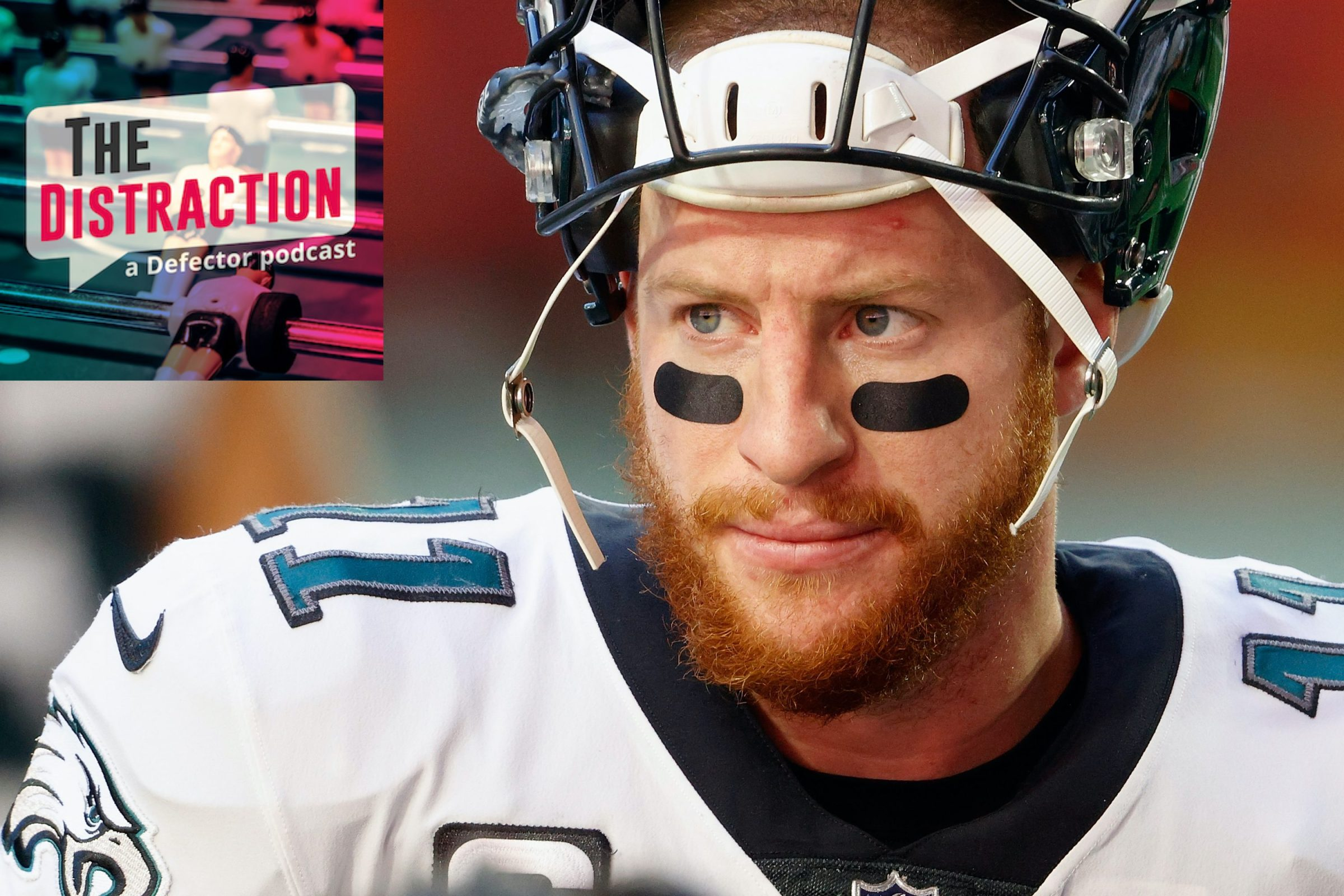 Carson Wentz, seen here warily assessing The Distraction logo.