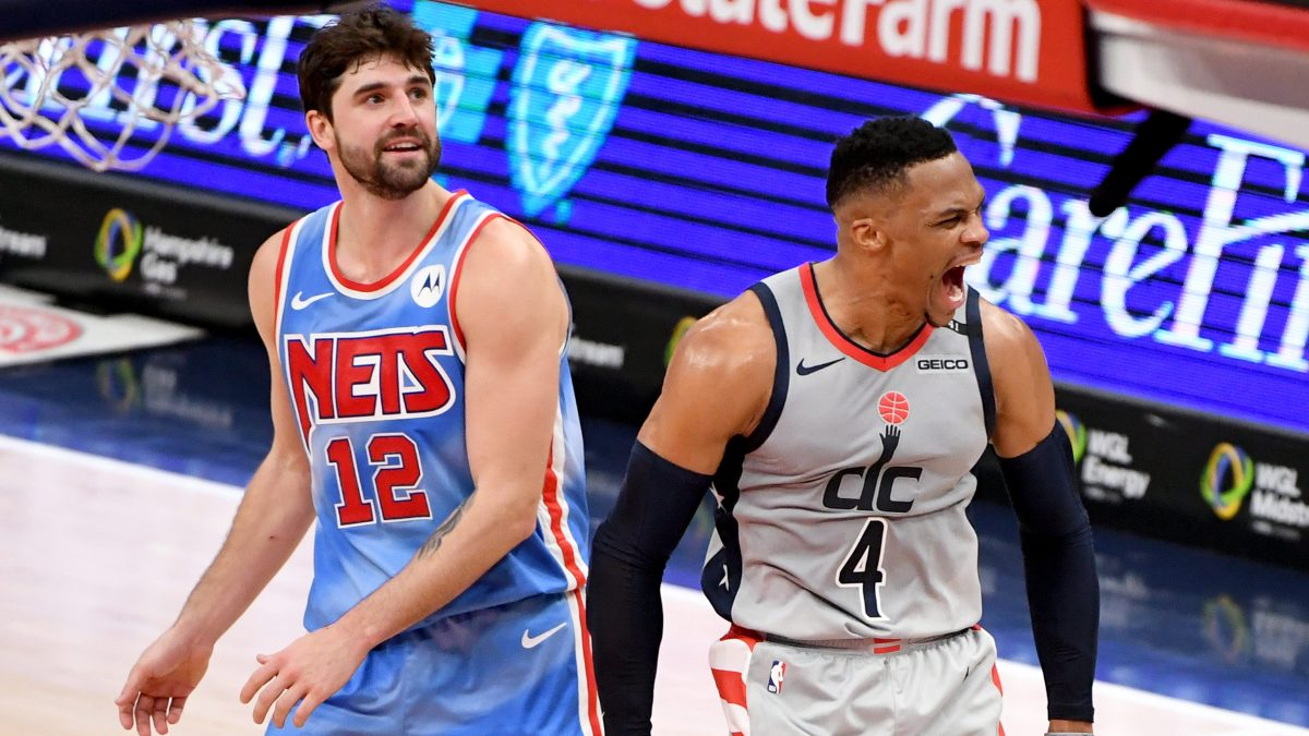 Russell Westbrook celebrates hitting the game-winning shot as Joe Harris looks on