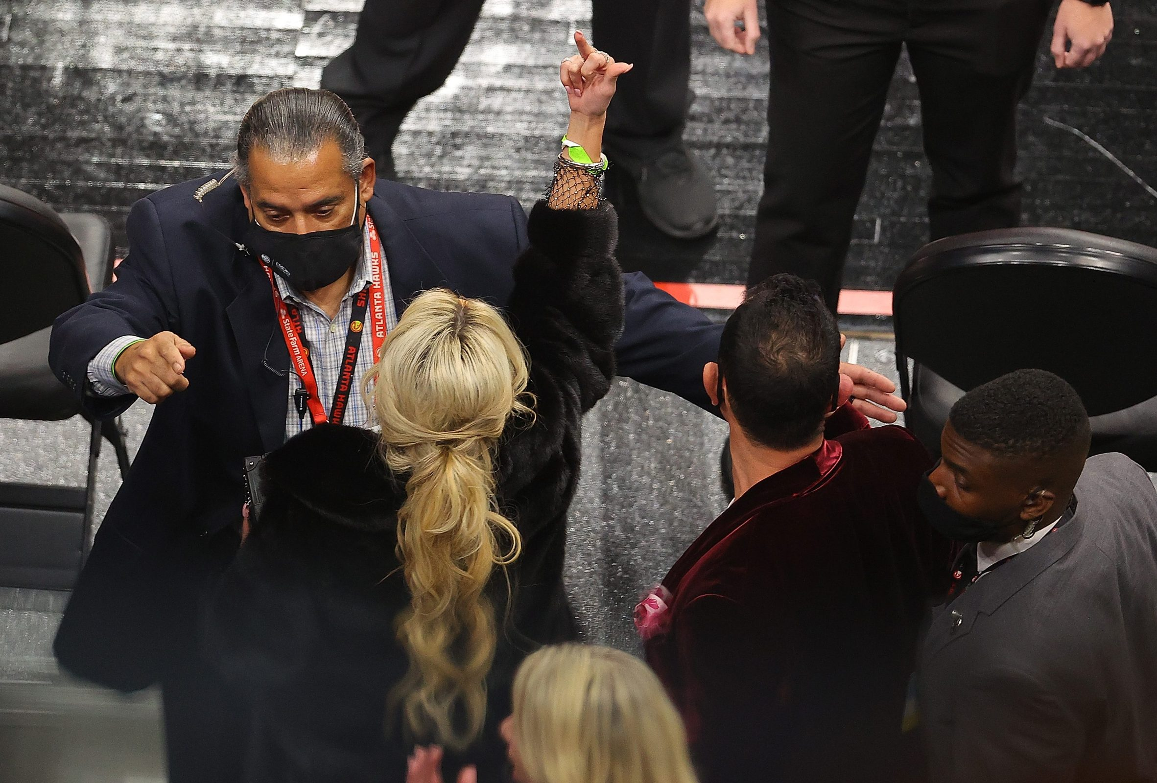 A fan gestures as she and her party are escorted out of the arena during the second half of the game between the Los Angeles Lakers and the Atlanta Hawks at State Farm Arena on February 01, 2021 in Atlanta, Georgia.