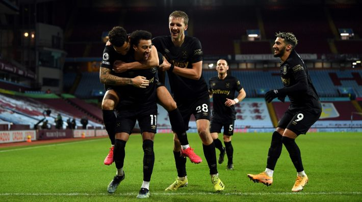 Jesse Lingard of West Ham United is congratulated by team mates Ryan Fredericks, Tomas Soucek and Said Benrahma after scoring his second goal during the Premier League match between Aston Villa and West Ham United at Villa Park on February 03, 2021 in Birmingham, England.