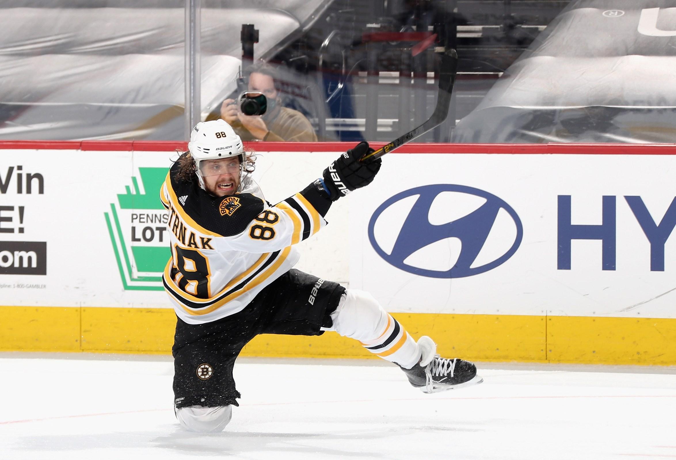 David Pastrnak #88 of the Boston Bruins takes a slapshot