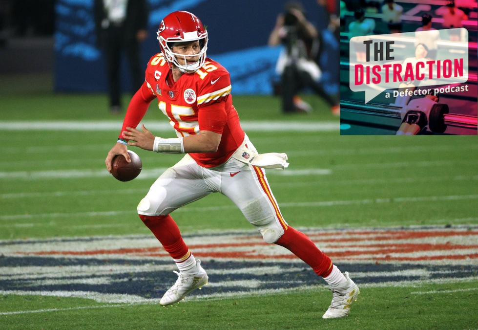 Patrick Mahomes, seen here running away from The Distraction podcast logo.