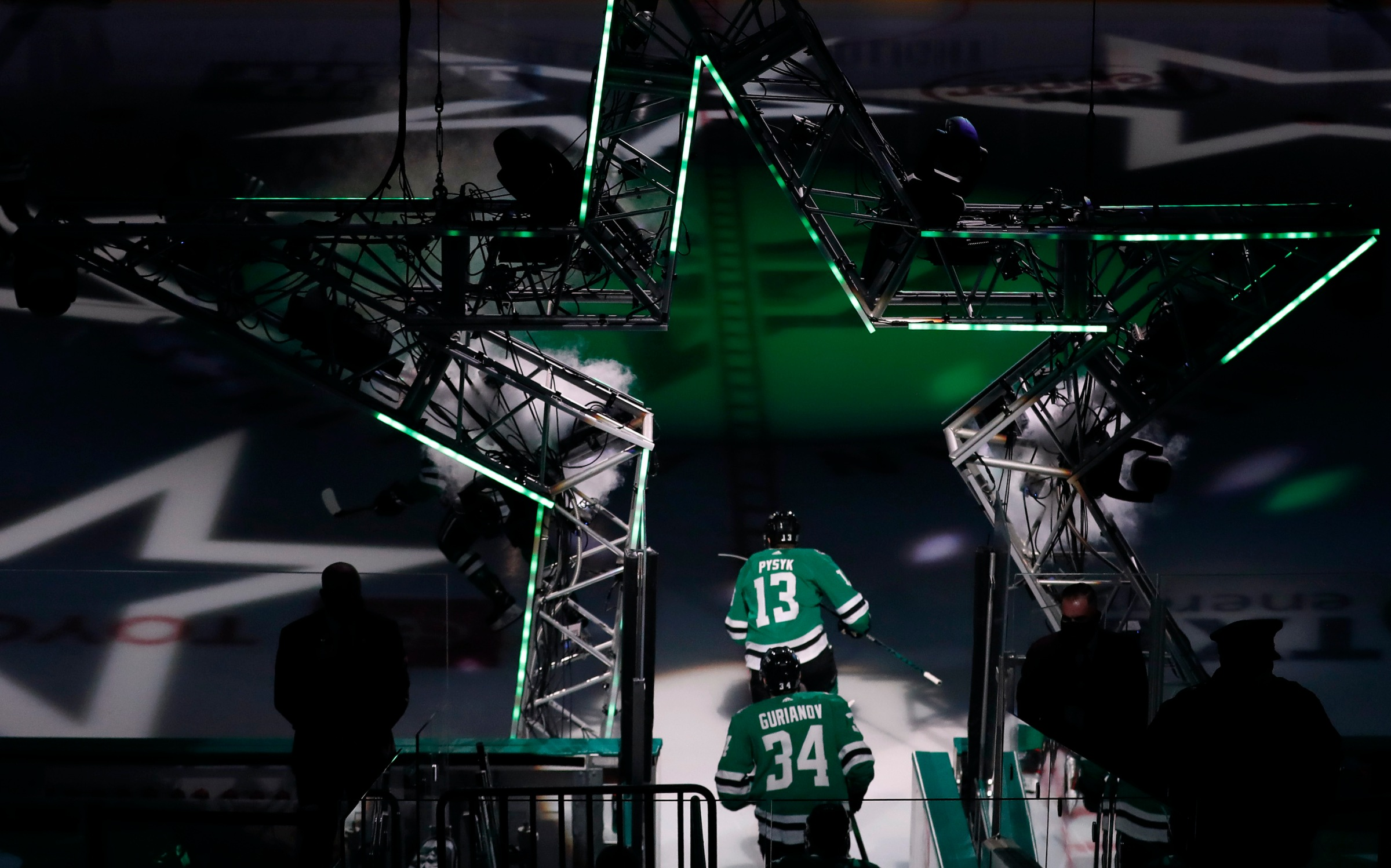 Mark Pysyk #13 of the Dallas Stars and Denis Gurianov #34 of the Dallas Stars take the ice against the Chicago Blackhawks at American Airlines Center on February 09, 2021 in Dallas, Texas.