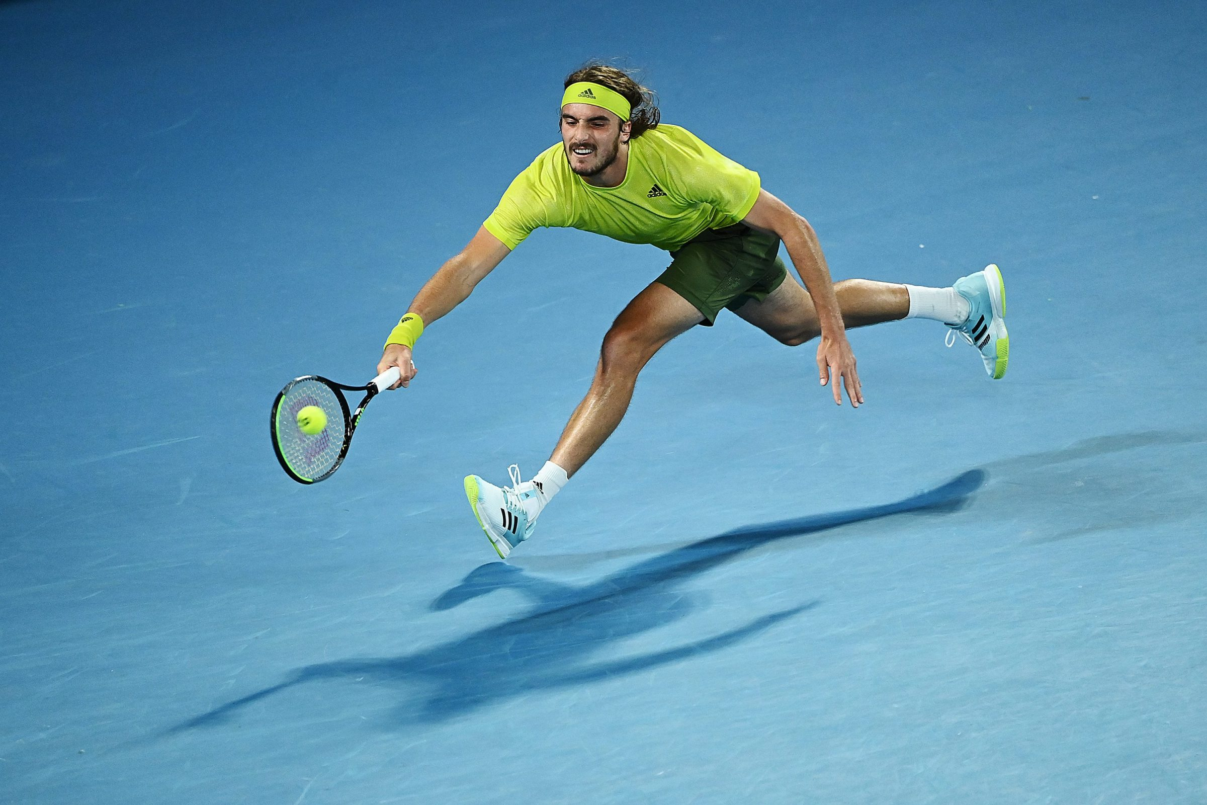 Stefanos Tsitsipas of Greece plays a forehand during his Men's Singles Quarterfinals match against Rafael Nadal of Spain during day 10 of the 2021 Australian Open at Melbourne Park on February 17, 2021 in Melbourne, Australia.