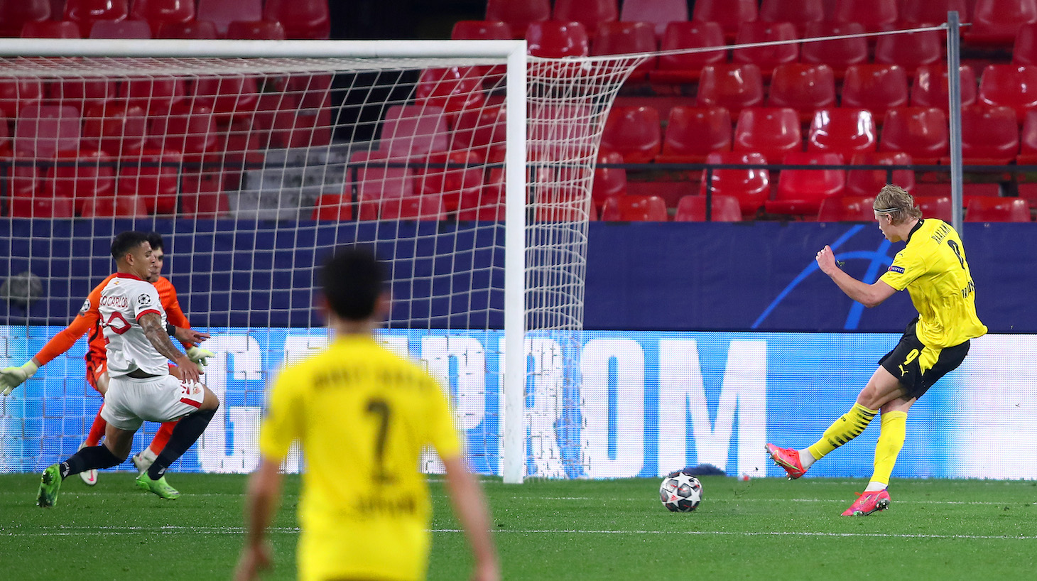 Erling Haaland of Borussia Dortmund scores their side's third goal during the UEFA Champions League Round of 16 match between Sevilla FC and Borussia Dortmund at Estadio Ramon Sanchez Pizjuan on February 17, 2021 in Seville, Spain. Sporting stadiums around Spain remain under strict restrictions due to the Coronavirus Pandemic as Government social distancing laws prohibit fans inside venues resulting in games being played behind closed doors.