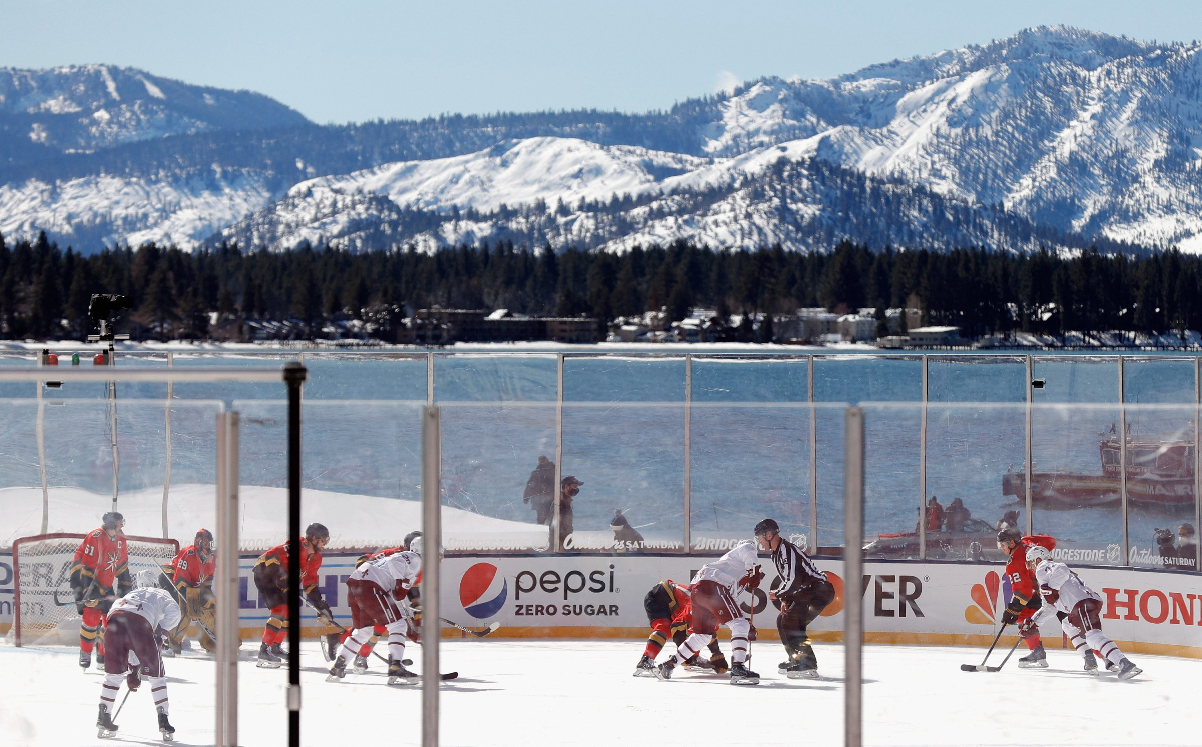 STATELINE, NEVADA - FEBRUARY 20: The Vegas Golden Knights skate against the Colorado Avalanche during the NHL Outdoors at Lake Tahoe at the Edgewood Tahoe Resort on February 20, 2021 in Stateline, Nevada. (Photo by Ezra Shaw/Getty Images)