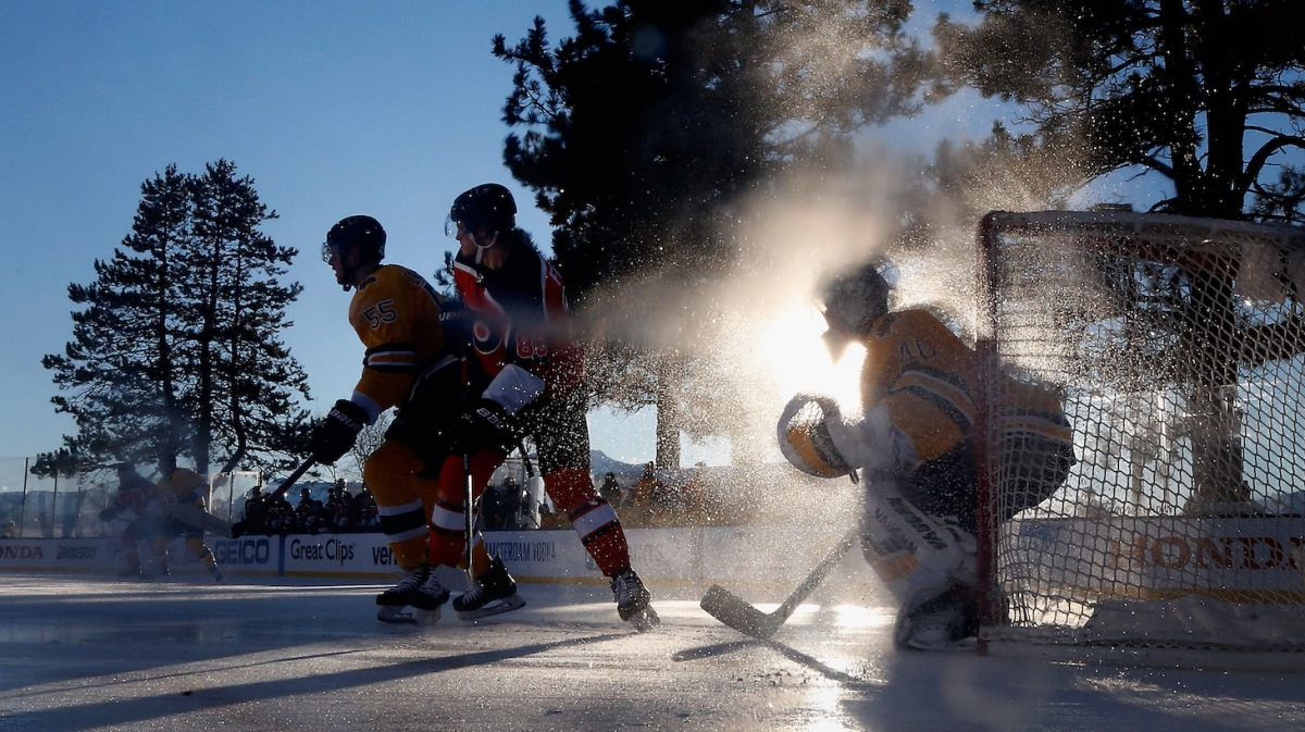 STATELINE, NEVADA - FEBRUARY 21: Goaltender Tuukka Rask #40 of the Boston Bruins follows the play as Joel Farabee #86 of the Philadelphia Flyers and Jeremy Lauzon #55 set up in front during the first period of the 'NHL Outdoors At Lake Tahoe' at the Edgewood Tahoe Resort onFebruary 21, 2021 in Stateline, Nevada. The Bruins defeated the Flyers 7-3. (Photo by Christian Petersen/Getty Images)