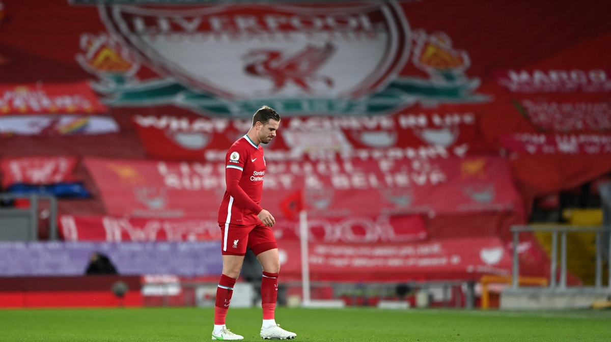 Jordan Henderson of Liverpool leaves the pitch as he is substituted off due to injury during the Premier League match between Liverpool and Everton at Anfield on February 20, 2021 in Liverpool, England