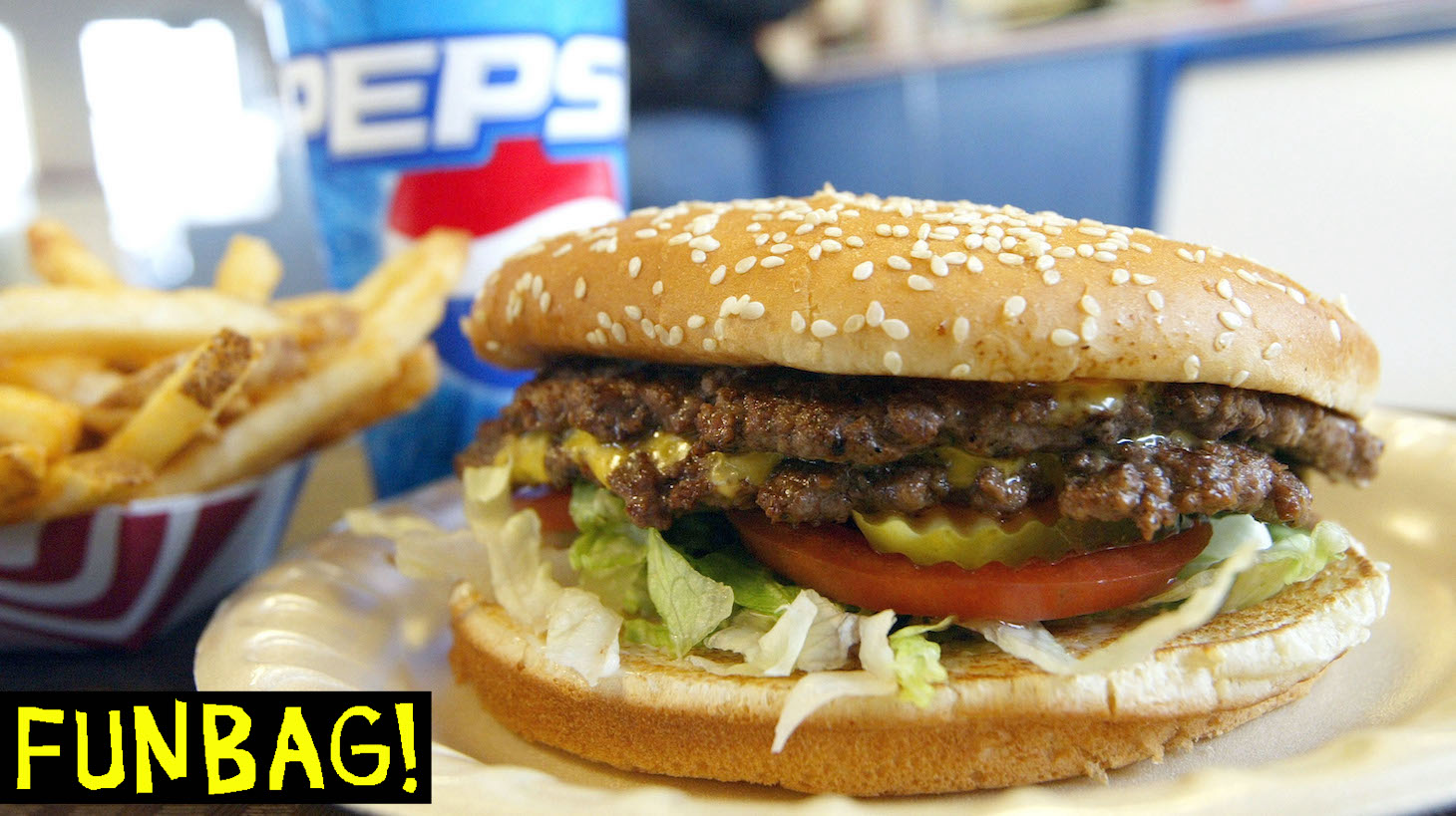 YAKIMA, WA - DECEMBER 28: A double cheeseburger, fries and soda lie on a table at Majors Hamburgers December 28, 2003 in Yakima, Washington. Two farms have been quarantined in Sunnyside and Mabton, Washington by the U.S.D.A after it was determined that a cow that came from the farms had been infected with mad cow disease, the first such case in the U.S. (Photo by Justin Sullivan/Getty Images)