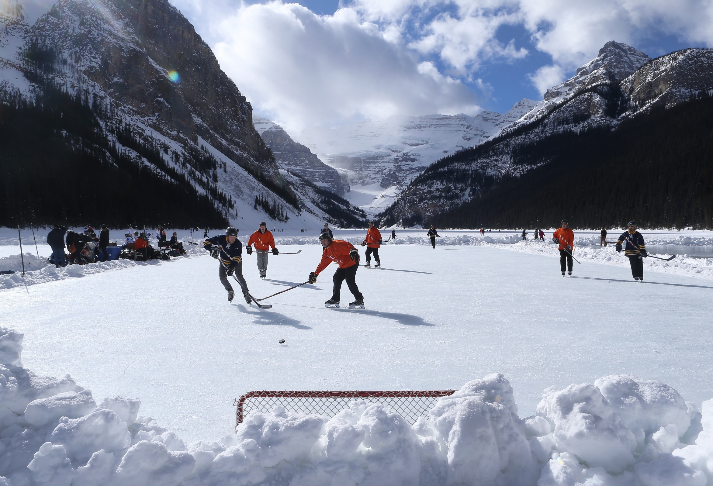 Outdoor shinny hockey action during the 7th Annual Lake Louise Pond Hockey Classic on the frozen surface of Lake Louise on February 27, 2016 in Lake Louise, Alberta, Canada.