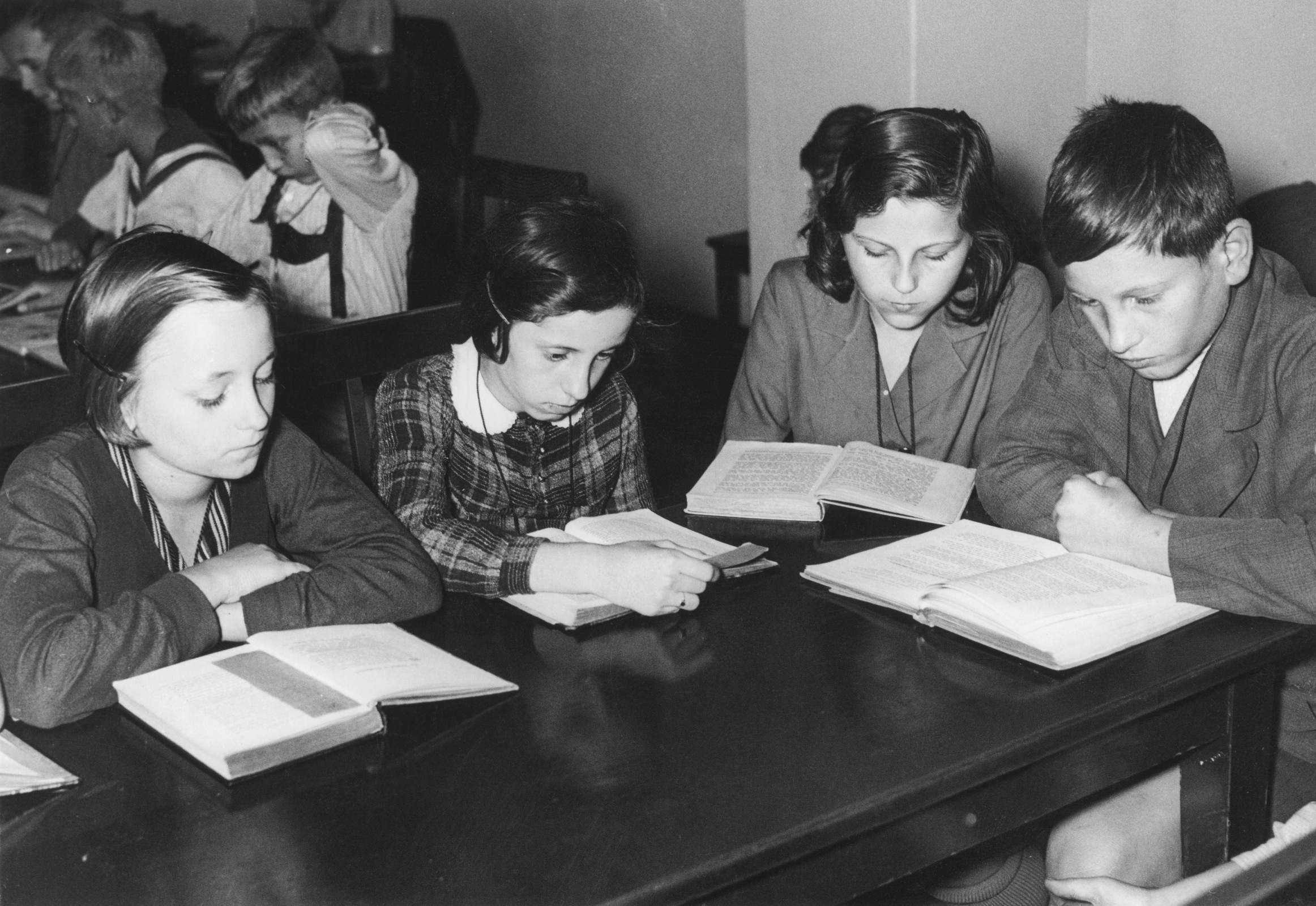 Children reading in the library at their school in Alsace, circa 1950.