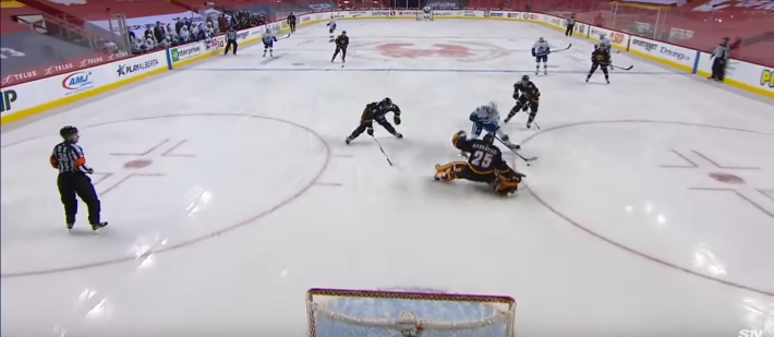 Jacob Markstrom leaves his net to try and make a save