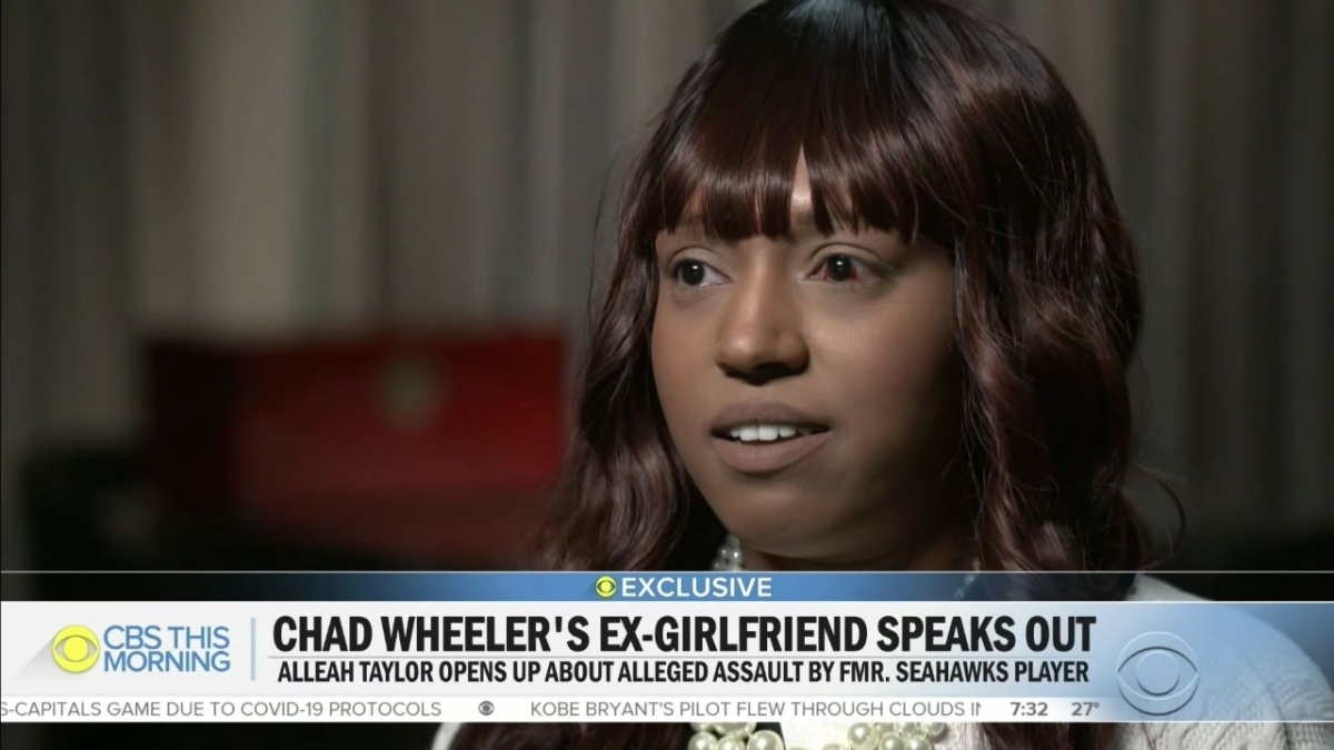 A photo of Alleah Taylor as she speaks to CBS This Morning about being attacked by her ex-boyfriend, former Seattle Seahawks lineman Chad Wheeler. She is wearing a white blouse and has one arm in a sling.
