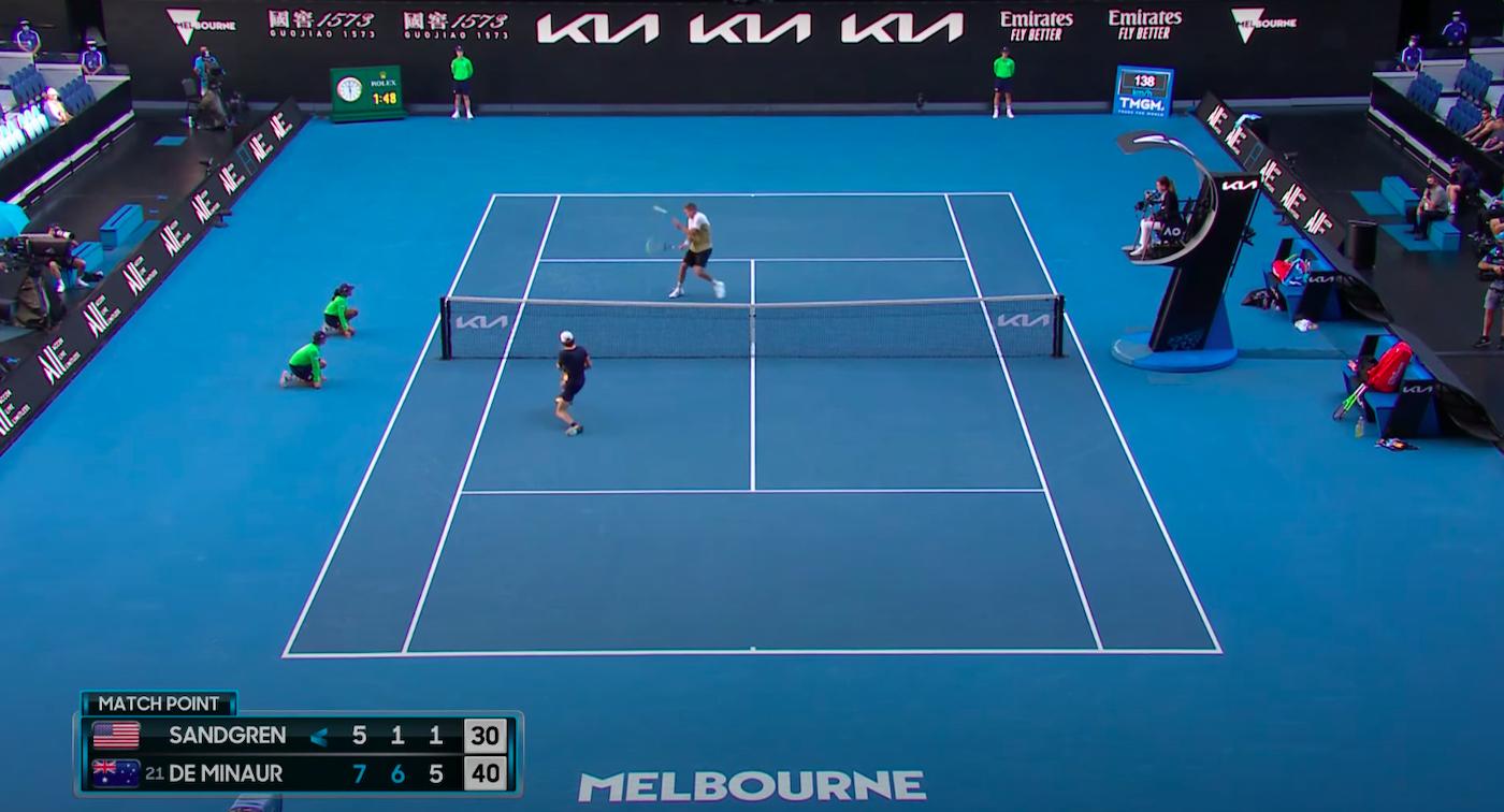 Alex de Minaur hits Tennys Sandgreen with a tennis shot.