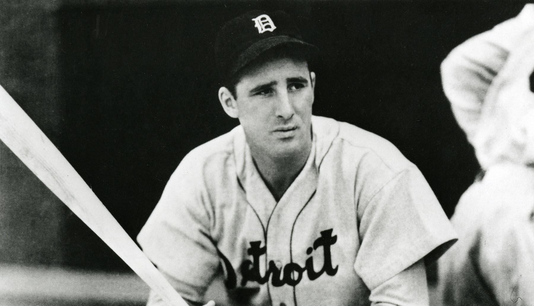 Hank Greenberg of the Detroit Tigers in dugout with bats, no date