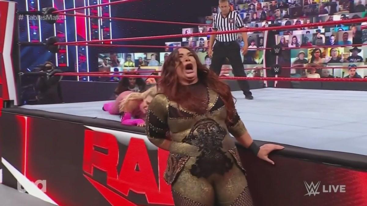 "Nia Jax yells ""my hole!"" after landing hard on the ring apron during WWE Monday Night Raw"