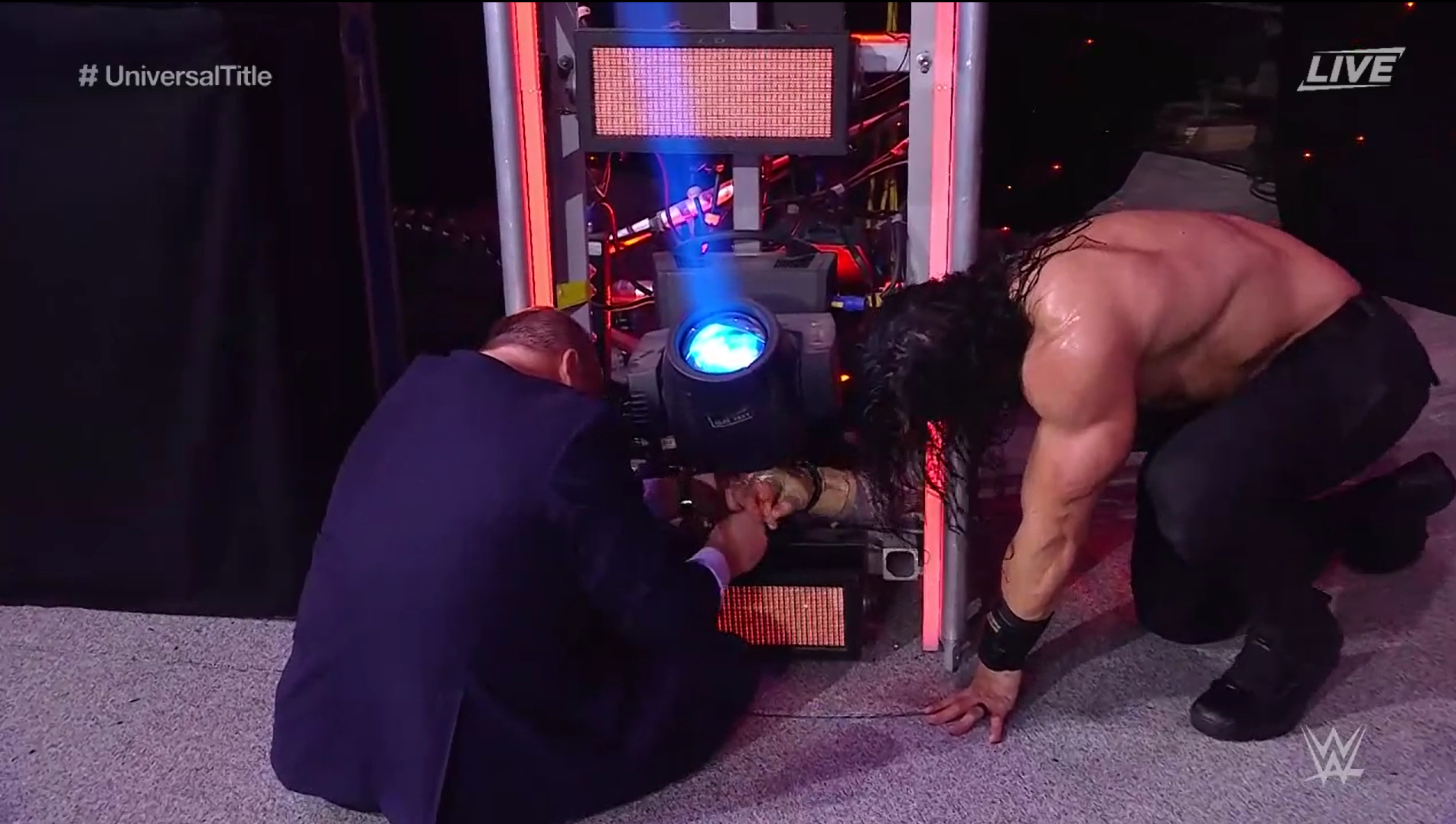 Roman Reigns and Paul Heyman struggle with handcuffs at the Royal Rumble
