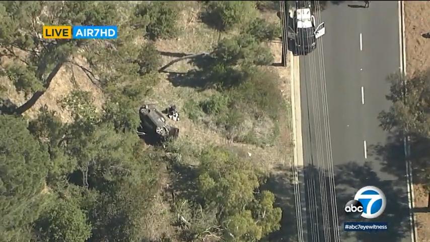 Scene of single-vehicle rollover involving golfer Tiger Woods.