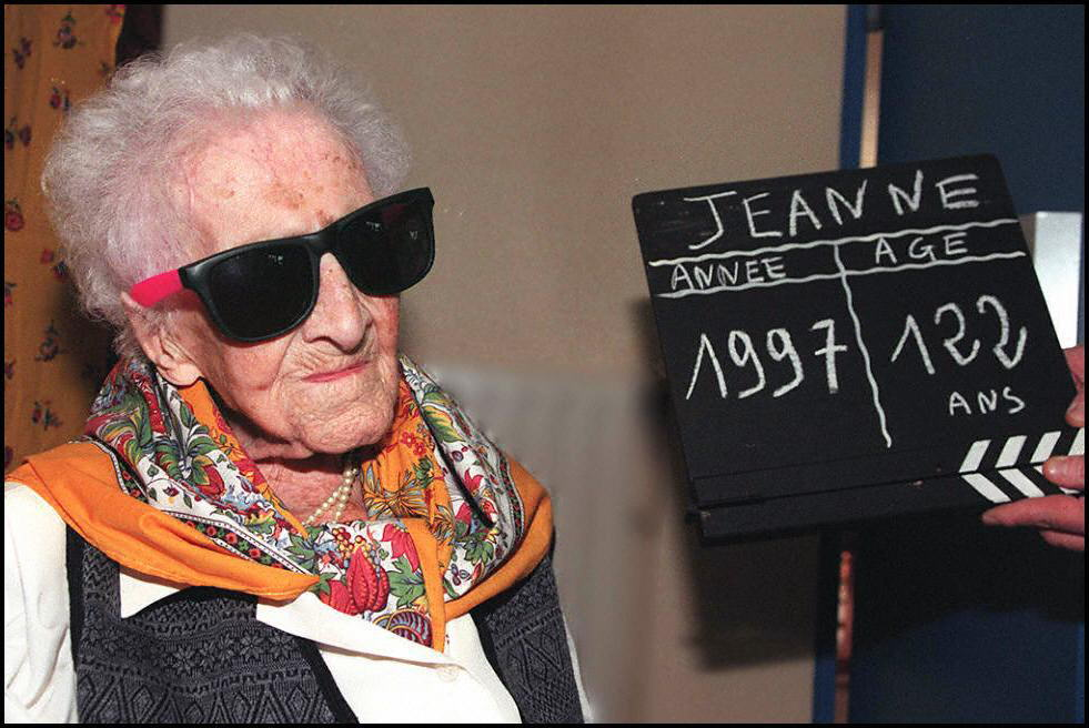 Jeanne Calment, the world's oldest woman, poses for photographers 20 February in Arles, southern France, a day prior her birthday. Calment will celebrate on Friday her 122nd birthday. (Photo by Georges GOBET / AFP) (Photo credit should read GEORGES GOBET/AFP via Getty Images)