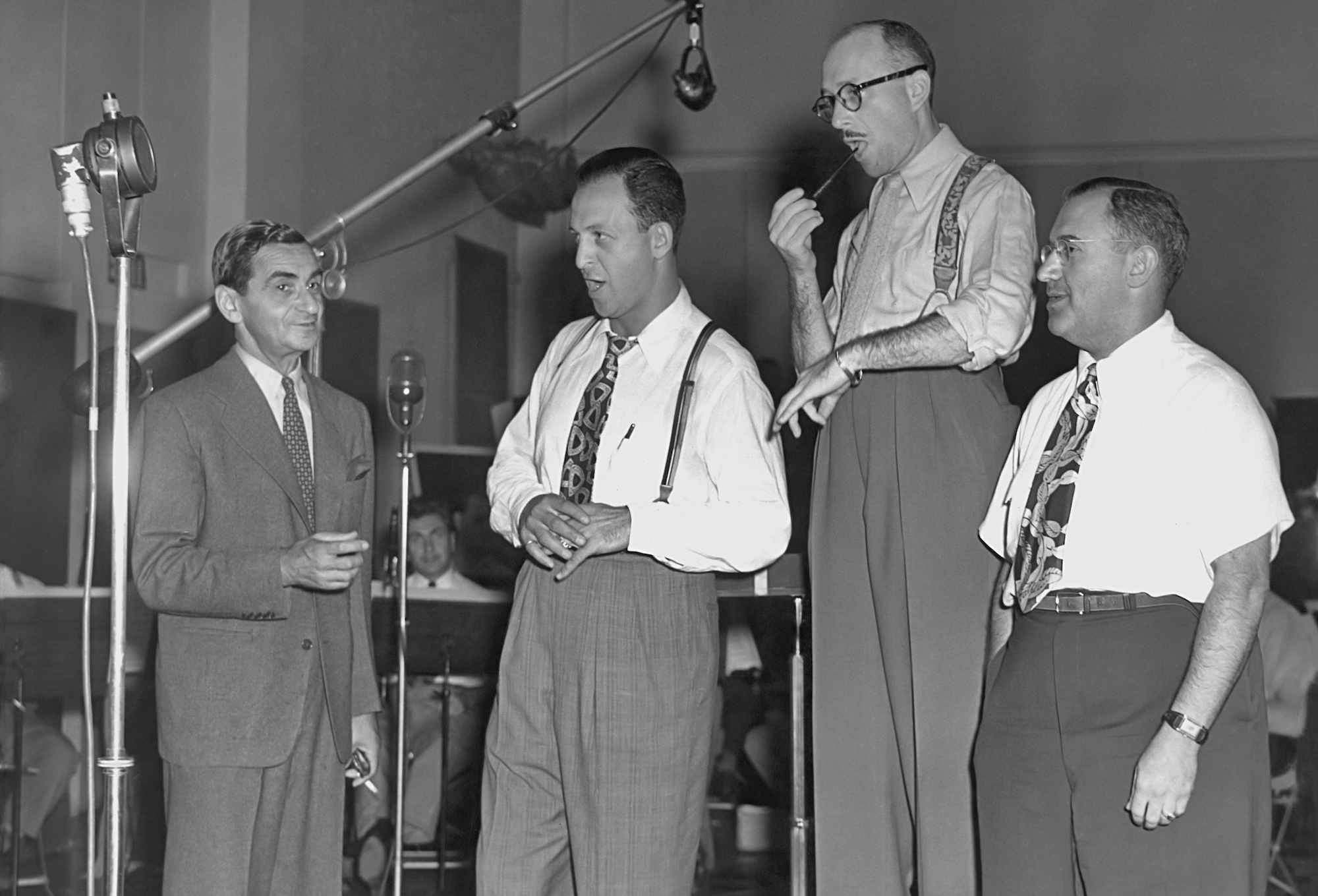 Composer Irving Berlin (1888 Ð 1989) with singer Barry Wood (1909 - 1970) and orchestra leader Ray Bloch (1902 - 1982) recording a song in the 1940's. (Photo by Archive Photos/Getty Images)