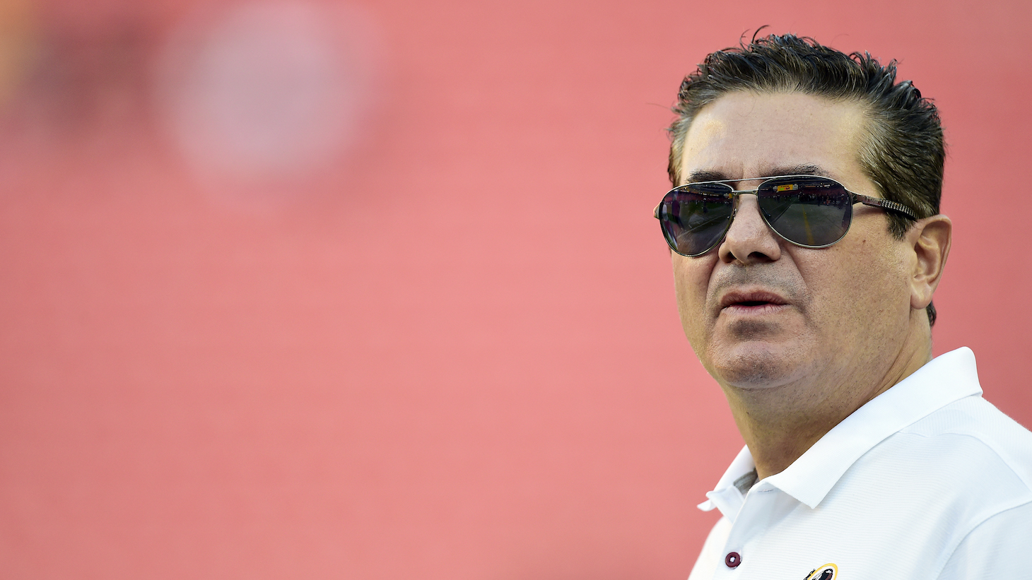 LANDOVER, MD - AUGUST 29: Washington Redskins owner Dan Snyder stands on the field before a preseason game between the Baltimore Ravens and Redskins at FedExField on August 29, 2019 in Landover, Maryland. (Photo by Patrick McDermott/Getty Images)