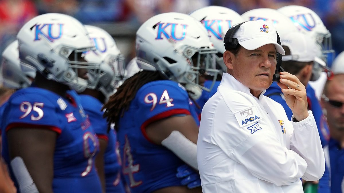 Former head coach Les Miles of the Kansas Jayhawks watches from the sidelines during the game against the Indiana State Sycamores at Memorial Stadium on August 31, 2019 in Lawrence, Kansas.