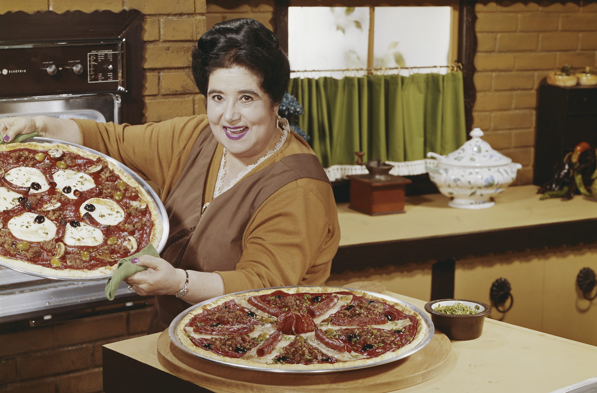 Woman preparing pizza in kitchen, portrait