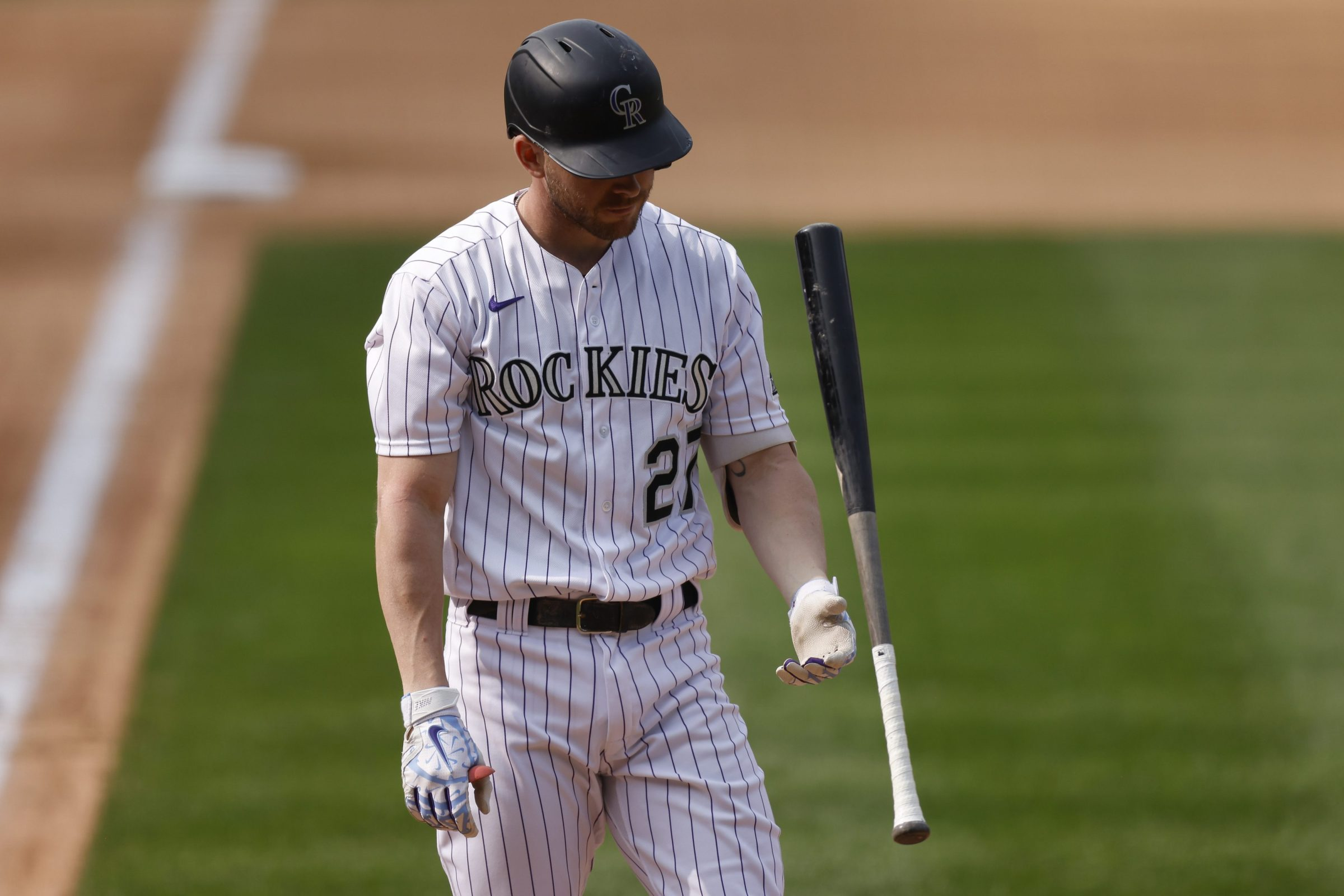 Rockies shortstop Trevor Story discards his bat after striking out.