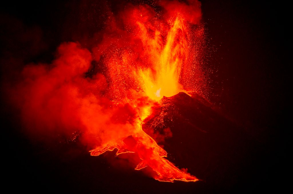 Lava flows down from the peak of Mount Etna in Sicily