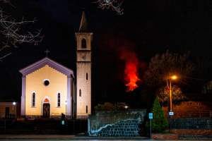 A pretty Sicilian church, and a scary red lava flow in the background
