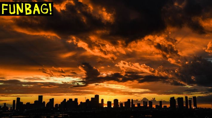 TOPSHOT - The Miami skyline is seen as the sun sets in the background in South Bay, Miami Beach, on February 24, 2021. (Photo by CHANDAN KHANNA / AFP) (Photo by CHANDAN KHANNA/AFP via Getty Images)