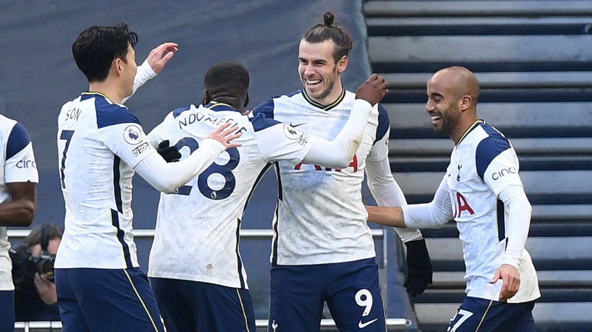 Tottenham Hotspur's Welsh striker Gareth Bale (C) celebrates with teammates after scoring their fourth goal during the English Premier League football match between Tottenham Hotspur and Burnley at Tottenham Hotspur Stadium in London, on February 28, 2021.