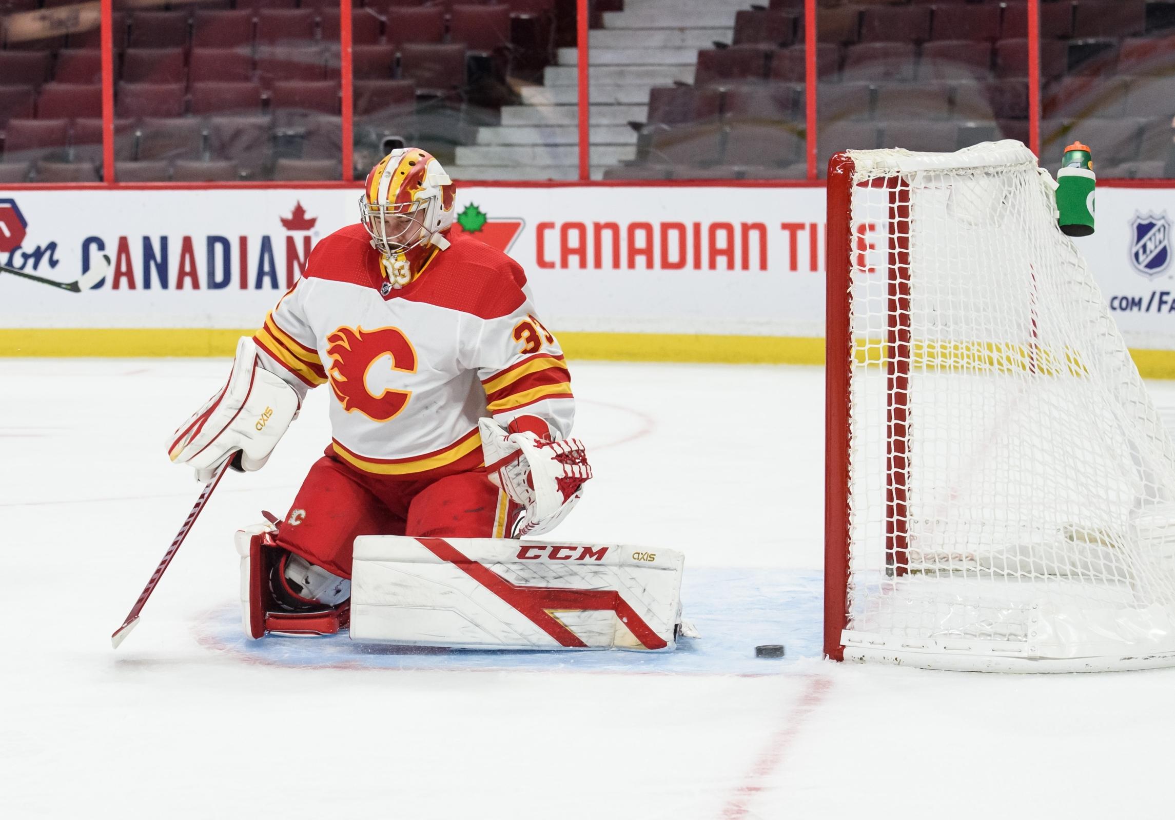 David Rittich of the Calgary Flames allows a goal