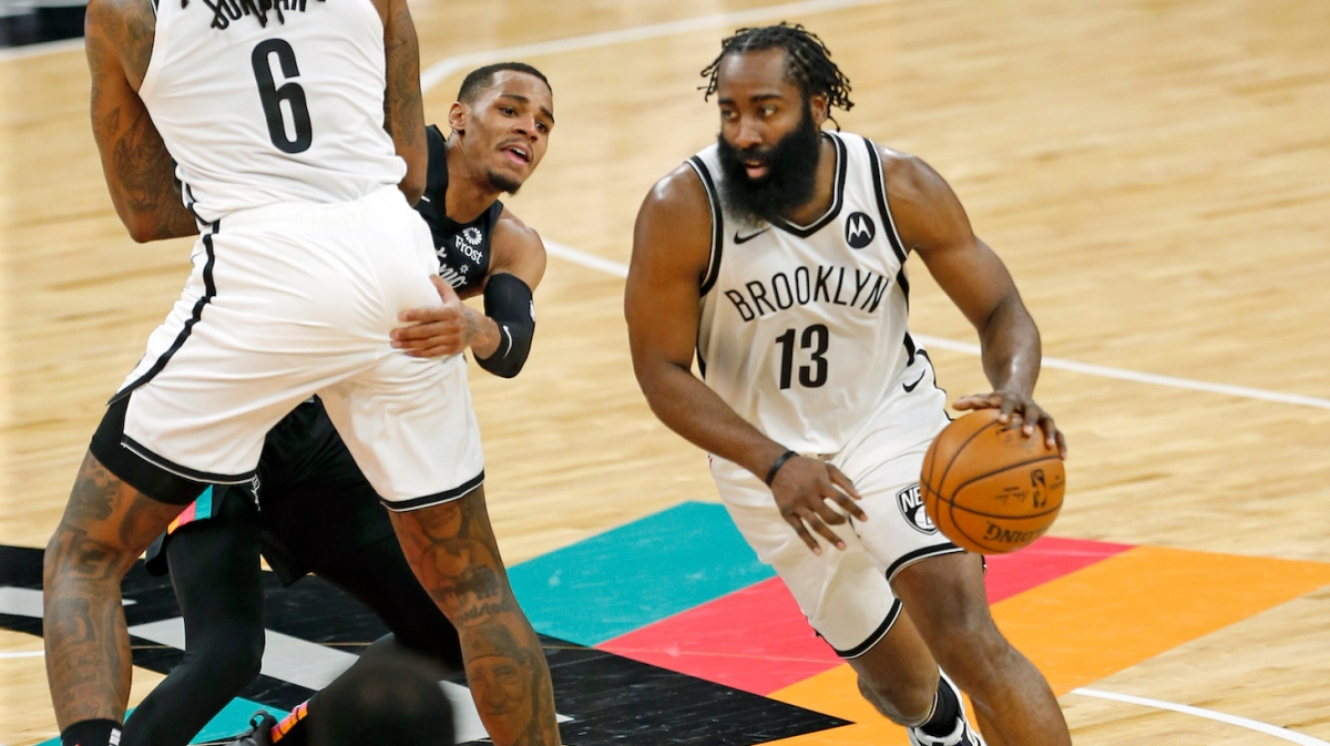 SAN ANTONIO, TX - MARCH 1: James Harden #13 of the Brooklyn Nets drives off a screen by DeAndre Jordan #6 against Dejounte Murray #5 of the San Antonio Spurs in the second half at AT&T Center on March 1, 2021 in San Antonio, Texas. NOTE TO USER: User expressly acknowledges and agrees that , by downloading and or using this photograph, User is consenting to the terms and conditions of the Getty Images License Agreement. (Photo by Ronald Cortes/Getty Images)